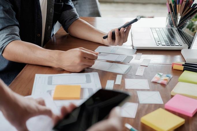 Web designer planning application for mobile phone.