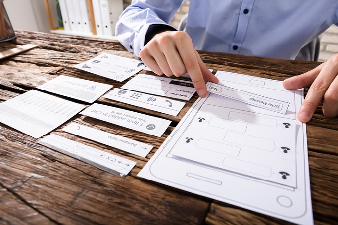 Close-up Of A Designer's Hand Designing Mobile Application