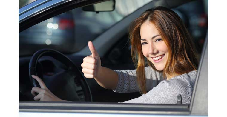 picture of a woman , a woman sitting in a car