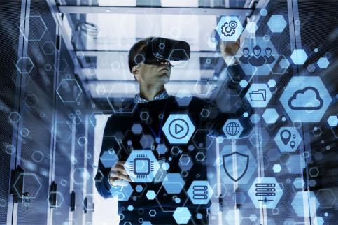 가상현실과 증강현실을 통해 업무를 처리하고 있는 남자의 모습