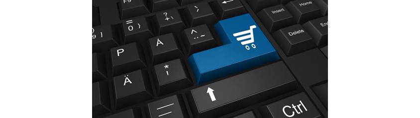 검은키보드에 엔터키에 쇼핑카트가 파란색으로 칠해져있는 이미지